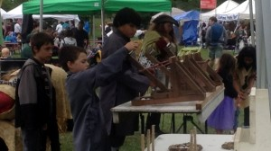 Atado Kids shooting toy catapults at the Royal Medieval Faire